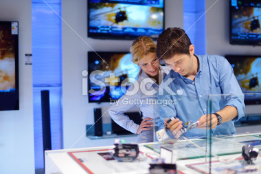 stock-photo-21560992-couple-in-consumer-electronics-store